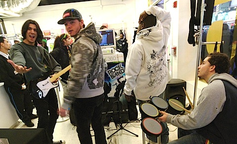 "Teens playing ""Rock Band"" in Times Square"