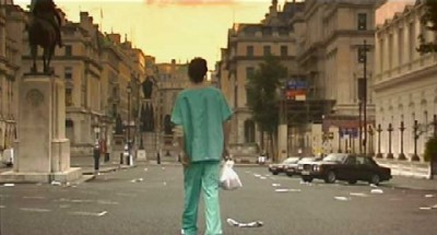 "Screen grab from ""28 Days Later."" Patient in hospital greens walks through abandoned London streets."