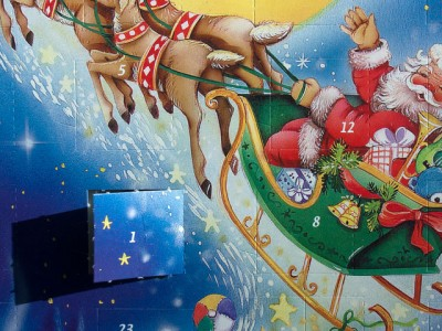 Image of a traditional Advent calendar, with the first door open.