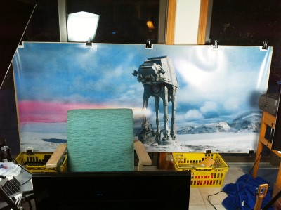 Big 90 inch by 40 inch backdrop of the Battle of Hoth, in the far wall of my podcasting studio.
