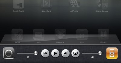 Partial screenshot of an iPad running iOS 4.2, showing the dock toolbar. Screen lock button, iPod playback controls, and sliders for volume and brightness are visible, plus an AirPlay button.