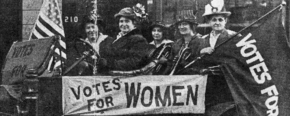 Vintage newspaper photo of suffragettes holding
